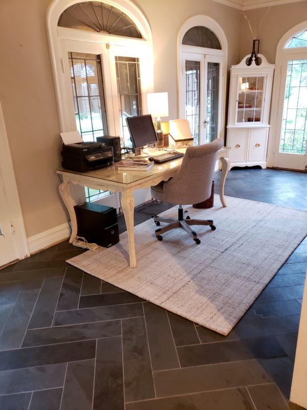 Office with black slate tile in herringbone pattern